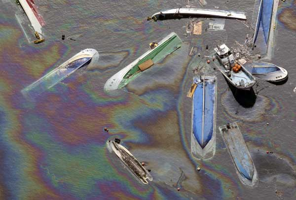 Vessels float on oil spilled water in Fudai, Iwate, northern Japan Monday, March 14, 2011 following Friday&#39;s massive earthquake and the ensuing tsunami.  <span class=meta>(&#40;AP Photo&#47;Yomiuri Shimbun, Hiroshi Adachi&#41;)</span>